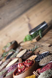 Nutitrion theme, spices. Set of colorful spices in different bowls on wooden table Stock Image
