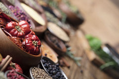 Nutitrion theme, spices. Set of colorful spices in different bowls on wooden table Royalty Free Stock Images