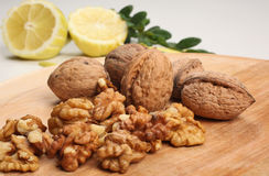 Nutmeat and nuts. On wooden plate Stock Images
