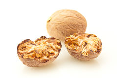 Nutmeg. Spice over white background stock image