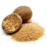 Nutmeg. Fresh ground nutmeg on white ground royalty free stock photography