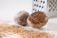 Nutmeg. With a little grater on back, low DOF Royalty Free Stock Photo