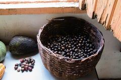 Nutmeg bounty in wicker basket royalty free stock photography