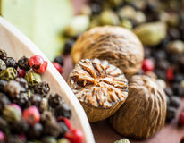 Nutmeg with broken part Royalty Free Stock Photography