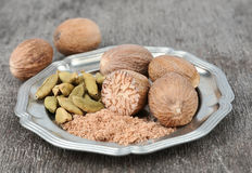 Nutmeg and cardamom Royalty Free Stock Photography