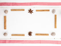Nutmeg, cinamon and star anise with checked red ribbon Royalty Free Stock Photo