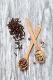Nutmeg, clove and allspice in old spoon on wood Royalty Free Stock Photo