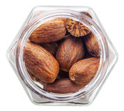 Nutmeg in a glass bottle Stock Images