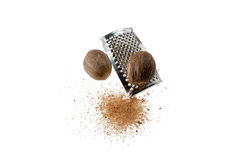 Nutmeg And Grater. Isolated On White Background stock photography