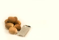 Nutmeg with grater Stock Photography