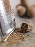Nutmeg And Grater. Close Up Of Nutmeg And Grater stock photography