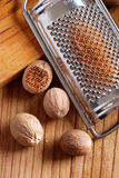 Nutmeg and grater Stock Image