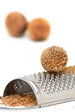 Nutmeg with grinder Stock Photography