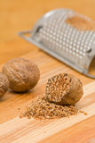 Nutmeg with grinder Royalty Free Stock Images