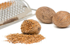 Nutmeg with grinder Royalty Free Stock Image