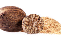 Nutmeg ,  half and ground on white background Stock Photography