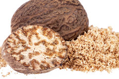 Nutmeg ,  half and ground on white background, close up Stock Images