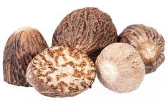 Nutmeg ,  half and whole isolated on white background Royalty Free Stock Photo