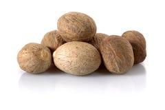 Nutmeg isolated on white Stock Images