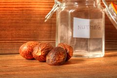 Nutmeg with jar Stock Photos
