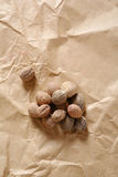 Nutmeg on kraft paper Royalty Free Stock Images