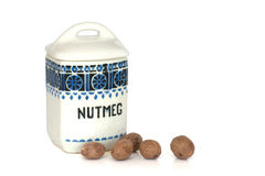 Nutmeg with old spice jar container Royalty Free Stock Image