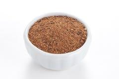 Nutmeg powder in a bowl on white background. stock photo