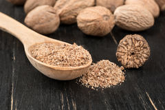 Nutmeg powder in spoon Royalty Free Stock Photography
