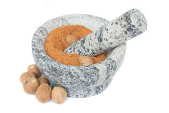 Nutmeg powdered in mortar on white Royalty Free Stock Image