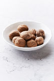 Nutmeg in small container Stock Images