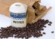 Nutmeg spice jar and coffee beans Royalty Free Stock Photography