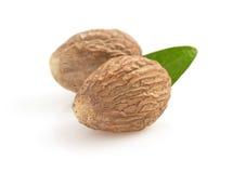 Nutmeg on white background Stock Photos