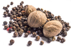 Nutmegs and black pepper Stock Photo