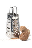 Nutmegs and grater Stock Photo