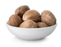 Nutmegs  in plate Stock Images