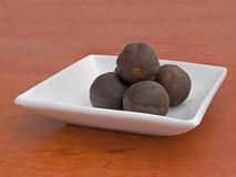 Nutmegs in saucer Royalty Free Stock Images
