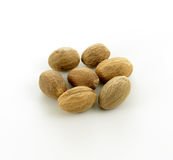 Nutmegs. Some nutmegs isolated on white background Stock Photo