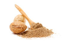 Nutmegs with spoon Royalty Free Stock Photography