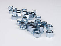 NutNbolts3. A long pile of nuts Stock Image