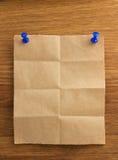 Nutowy papier na drewnie Zdjęcie Stock