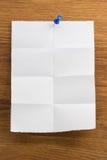 Nutowy papier na drewnie Obrazy Royalty Free