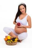 Nutrição apropriada durante a gravidez Vitaminas e fruto fotografia de stock royalty free