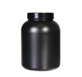 Nutrição do esporte, proteína do soro ou Gainer. Frasco plástico preto Imagens de Stock Royalty Free