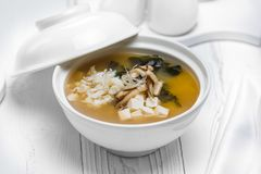 Nutricious fish soup with vegetables in a bowl stock image