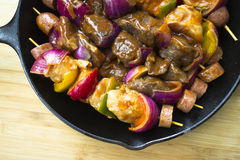 Nutrient kebabs of meat sausages and vegetables ready to cook Royalty Free Stock Image