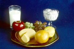 Nutrients. Display of nutritious foods , with drink and desert Stock Photography