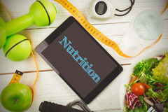 Nutrition against fit persons desk Royalty Free Stock Photos