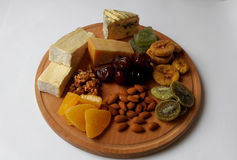 Nutrition. Cheese plate. healthy food. Hard cheese. Blue cheese. fruit and nuts Stock Photography
