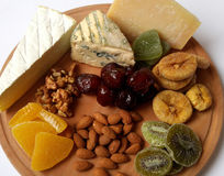 Nutrition. Closeup. Cheese plate. healthy food. Hard cheese. Blue cheese. fruit and nuts Royalty Free Stock Images