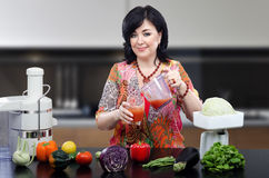 Nutrition coach pouring smoothie into glass Stock Photos